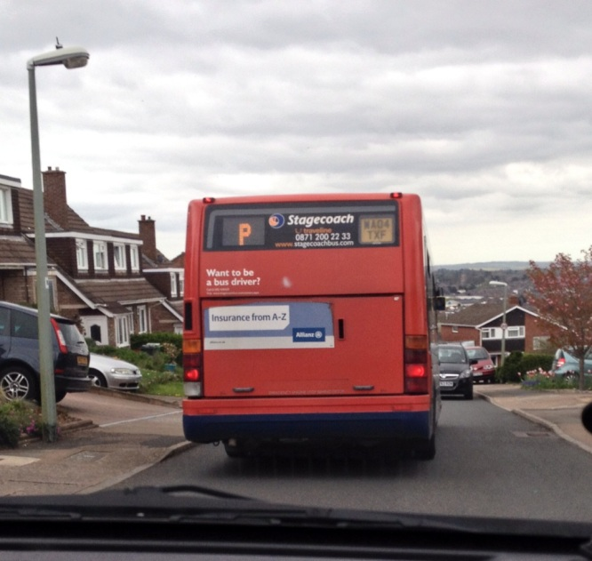 Cllr Heather Morris behind a P bus delayed by pavement parking in Barley Farm Road
