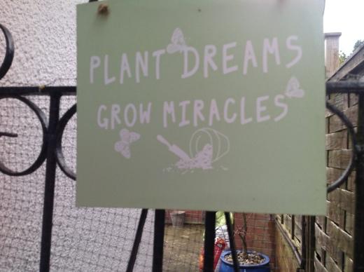 Sign on garden gate in Little John's Cross Hill