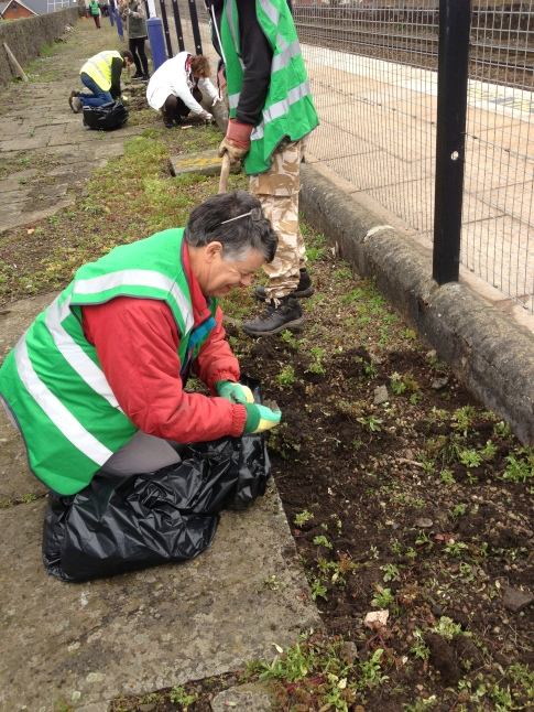 Paul Bull weeding at St Thomas Station
